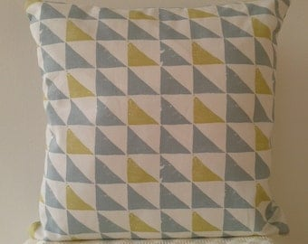 Geometric, contemporary blue/grey, citrus and white cushion with soft cushion pad.