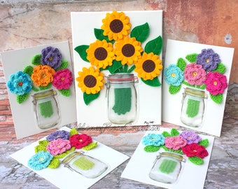 Bouquet of flowers on canvas.Crochet and embroidered flowers.