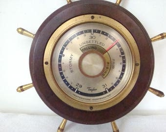 """Vintage working barometer made by Taylor Instrument Co from Rochester NY. Mahogany base. 8.5"""" diameter overall. In good working condition"""