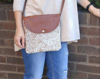 Speckled tan and white cowhide crossbody bag!