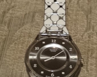 Swatch Elegantly Framed Ladies Watch SFK356G                                                                                        .
