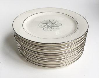10 small grey, blue swirl plates, silver rimmed