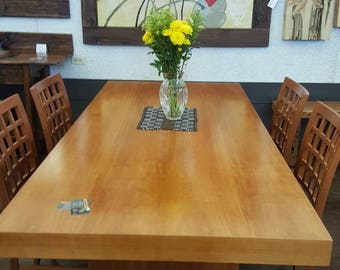 Contemporary dinning table finish in a beautiful cherry veneer.