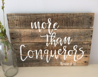 More Than Conquerors Bible Verse Wood Sign