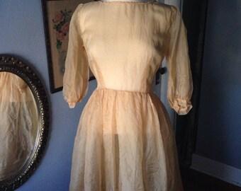 Gold 1950's silk organza dress.