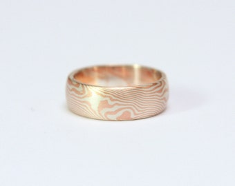 9ct red gold and sterling silver Mokume Gane wedding ring with woodgrain pattern