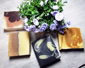 3 organic soaps and 1 organic solid shampoo