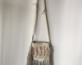 White handmade crossbody women's bag, real leather with fashionable leather fringe, bag decorated with colored beads, new, size small.