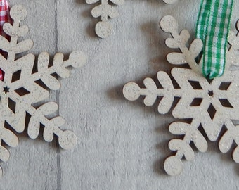 A hanging wooden snowflake decoration/ Christmas tree decoration