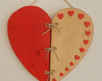 Wooden heart with red hearts