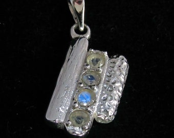 silver gemstone pendant with 4 round cut blue Moonstones