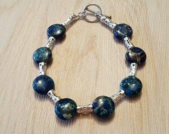Blue lentil beaded bracelet with silver accents