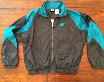 Black and teal Nike track jacket- medium
