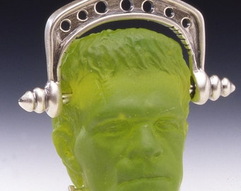 Frankenstein glass pendant with Sterling silver bail and neck bolts