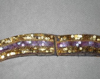 Un ceinture or et violette