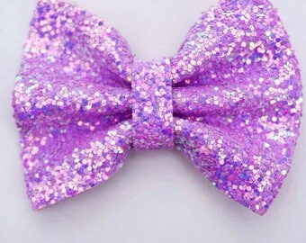 Purple chunky glitter bow on an alligator clip OR skinny elastic headband