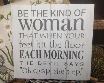 """Be the kind of woman that when your feet hit the floor in the morning the devil says """"Oh crap she's up"""" white distressed wood pallet sign"""
