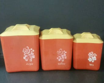 Vintage red plastic canister set. Sugar, coffee and tea.