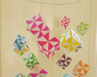 Paper Mobile cubes in bright colors. Children's room.
