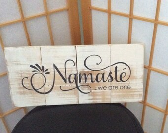 Rustic 'Namaste we are one' sign