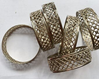 dainty filligree set of napkin rings  silver plated but light
