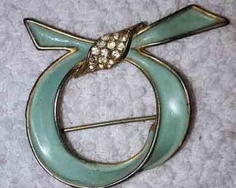 Vintage light blue Rhinestone Brooch in a Loose Knot Design Signed Les Bernard