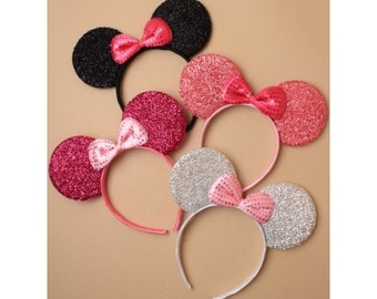 Sparkle Mouse Ears. Sparkly Mouse ears with bow on an aliceband in Black, Pink, Silver & Fuchsia. Fits Adults and Children.