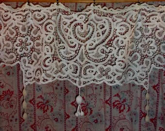 A curtain or valance made of antique lace