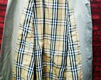 Trench coat burberrys made in england 23x43 nice designer