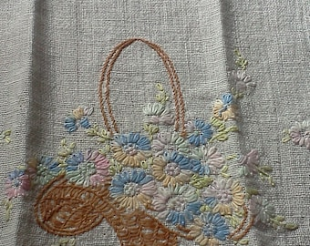 Vintage hand embroidered vanity cloth, dresser cloth, small table runner or doily.  Measures 10 x 20 inches.  Flower basket design.