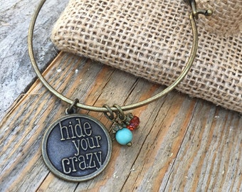 Antique gold bangle bracelet with hide your crazy charm and turquoise bead