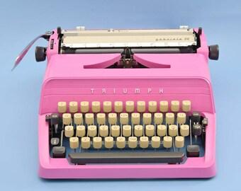 Pink Triumph Gabriele 30 typewriter with braille keyboard
