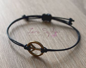 Elegant black bracelet with peace pendant