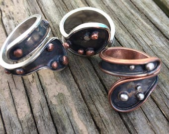 silver ring with copper balls