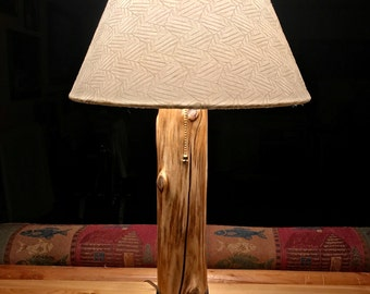 Rustic Cedar lamp with beach stone base and leather accents