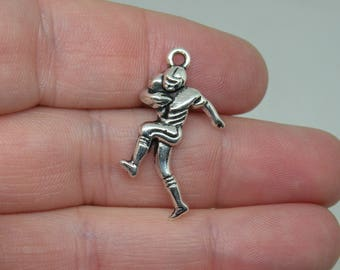 10 Silver Tone Football Player in Action Charms. B-015