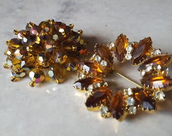 Set of 2 different Amber colored Brooches