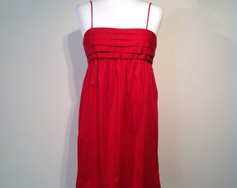 Woman retro style French Connection red party dress
