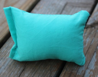 Solid teal colored catnip pillow