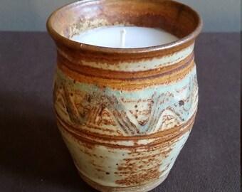 Hand spun pottery candle