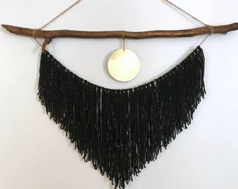 Gold disk black yarn hanging