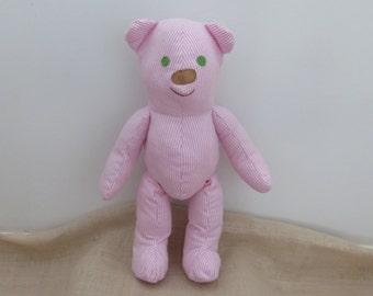 Kora. The cute, cuddly, pink stripe material, soft, handmade Teddy Bear with a purple wool scarf.