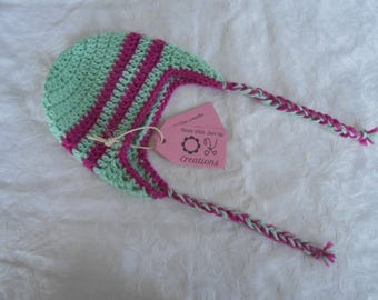 Green and pink handmade crocheted earflap hat