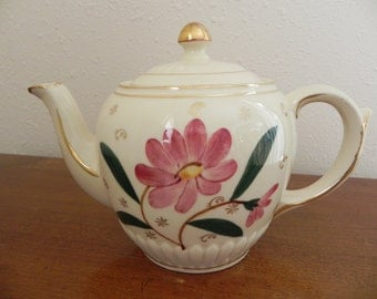 Vintage USA  Pottery Floral Teapot with a Whimsical Background Painted in Gold.