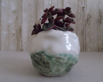 "Ceramic pot says ""Roquefort II"""