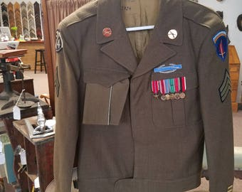 Vintage Antique Military. World War 2 , Army, 94th infantry jacket with Sargent stripes, Lapel pins, Rifle badge, 6 medals. WWII