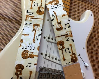 Stylish musical guitar strap -- guitars and musical symbols on a cream background