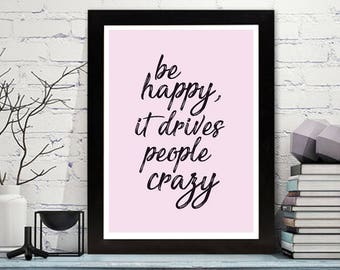 Stylish wall art print with inspirational quote 'be happy it drives people crazy'.