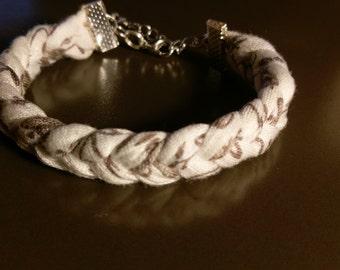 Broken and beige white braided bracelet