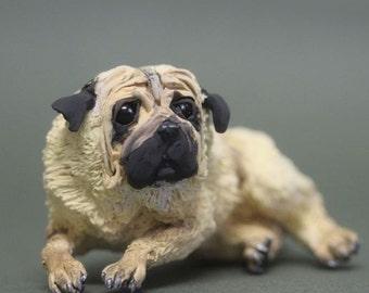 The figurine of the dog breed pug,dog statue,dog figurine,dog sculpture,pug
